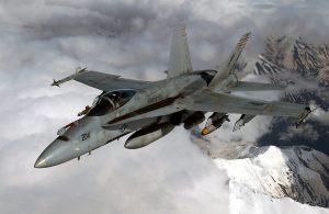 Aerial of a US Marine Corps (USMC) F/A-18 Hornet, Marine Fighter Attack Squadron-115 (VMFA-115), Silver Eagles, Beaufort, South Carolina (SC), armed with AIM-9 Sidewinder missiles (wing tips), a GBU-12 (left), and a MK-83 1,000 lbs Joint Direct Attack Munition (JDAM) during Operation IRAQI FREEDOM.